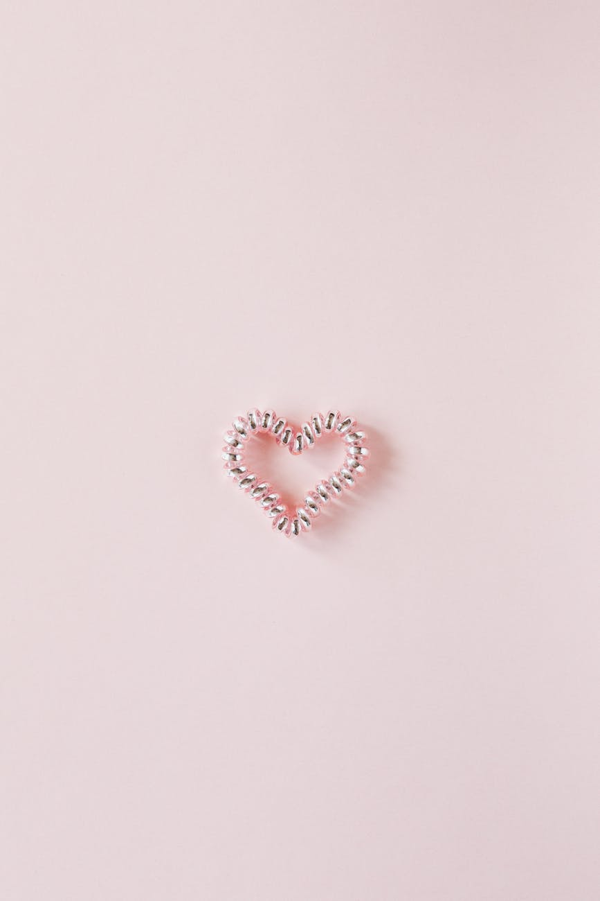 A pink heart on a pink background