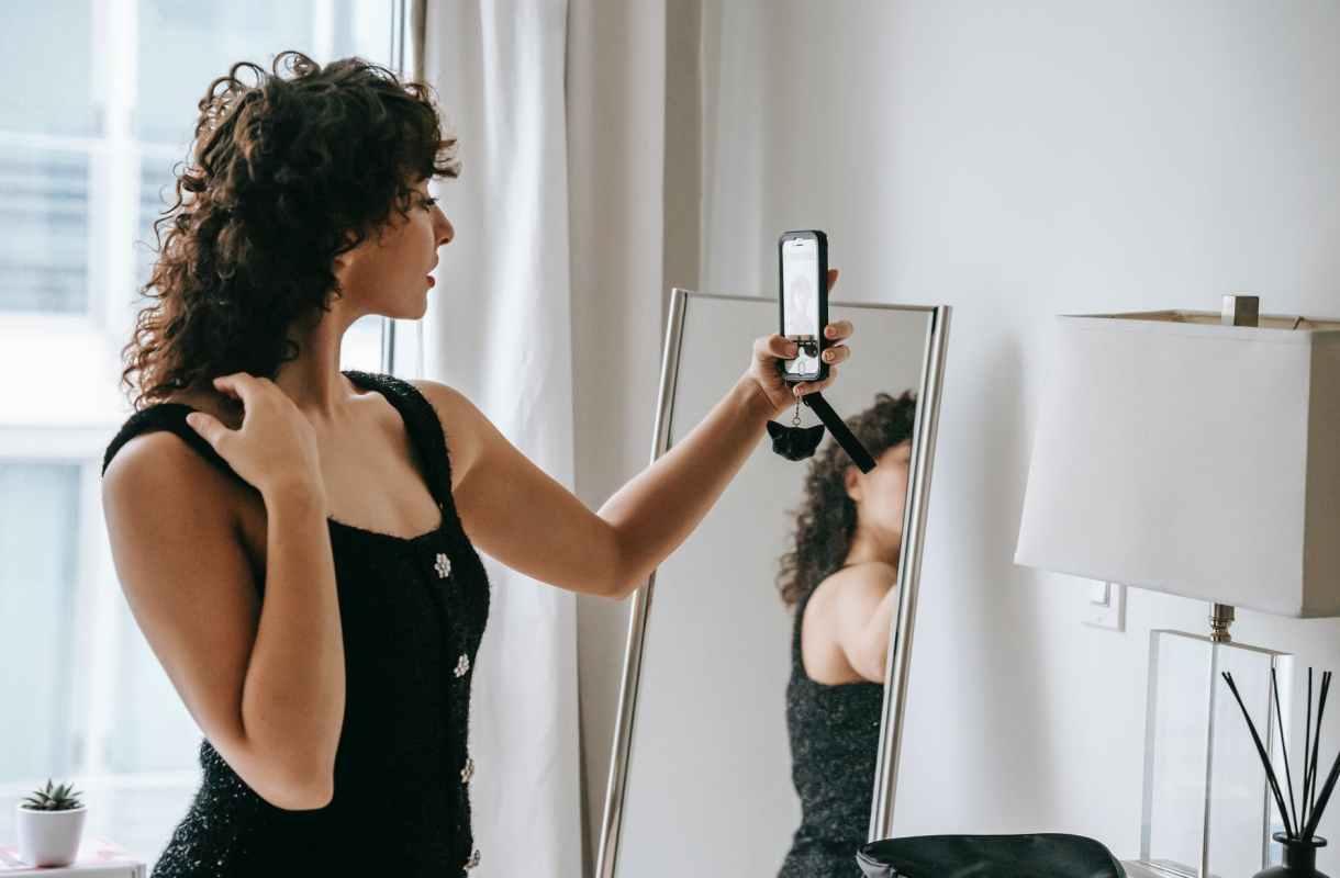 A woman looking fancy taking a mirror selfie